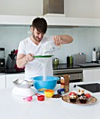 CAKE BOY HOUSE  LONDON: ERIC LANLARD  CAKE BOY  PREPARING A CAKE MIX IN HIS KITCHEN