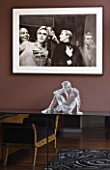 CAKE BOY HOUSE  LONDON: ICE SCULPTURE MADE OF GLASS  BY SCULPTOR BRUCE DENNY  ON A CHEST OF DRAWERS IN BEDROOM . ABOVE IS A PHOTOGRAPH OF ANDY WARHOL