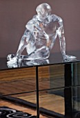 CAKE BOY HOUSE  LONDON: ICE SCULPTURE MADE OF GLASS  BY SCULPTOR BRUCE DENNY  ON A CHEST OF DRAWERS IN BEDROOM