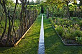 LE JARDIN DALCHIMISTE  PROVENCE  FRANCE: DESAIGNERS ARNAUD MAURIERES AND ERIC OSSART - RILL WITH LIVING WILLOW FENCES AND LAWN