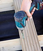 DESIGNER CLARE MATTHEWS - DECKING PROJECT - DRILLING SCREW INTO DECK BOARD