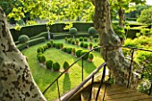 LES CONFINES  PROVENCE  FRANCE - DESIGNER: DOMINIQUE LAFOURCADE: TIMBER AND IRONWORK STAIRWAY TO VIEWING PLATFORM IN PLANE TREE AND VIEW OF CLIPPED EVERGREENS IN LAWN