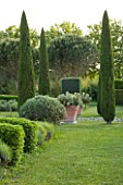 LES CONFINES  PROVENCE  FRANCE - DESIGNER: DOMINIQUE LAFOURCADE - CLIPPED CYPRESSES - CUPRESSUS SEMPERVIRENS - AND TERRACOTTA CONTAINERS WITH OPUNTIA CACTUS