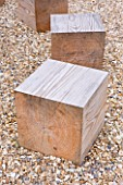 DECKING PROJECT - DESIGNER: CLARE MATTHEWS - SQUARE WOODEN BLOCKS IN GRAVEL USED AS SEATING