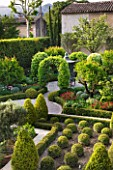 DESIGNER MICHEL SEMINI  PROVENCE  FRANCE: MAS THEO - THE EASTERN COURTYARD GARDEN WITH BOX HERDGING AND A PIGEON HOUSE