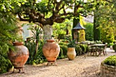 DESIGNER MICHEL SEMINI  PROVENCE  FRANCE: MAS THEO - GRAVEL COURTYARD WITH TERRACOTTA CONTAINERS
