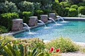 DESIGNER DOMINIQUE LAFOURCADE  PROVENCE  FRANCE: SWIMMING POOL WITH FOUR BRICK FOUNTAINS THAT SPURT RECYCLED WATER