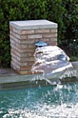 DESIGNER DOMINIQUE LAFOURCADE  PROVENCE  FRANCE: SWIMMING POOL WITH SQUARE BRICK FOUNTAIN THAT SPURTS RE-CYCLED WATER