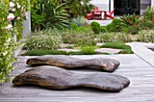 DESIGNER DOMINIQUE LAFOURCADE  PROVENCE  FRANCE: DECKING BESIDE THE SWIMMING POOL WITH CHAISE -LONGUES IN WOOD BY MARC NUCERA