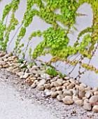 DESIGNER DOMINIQUE LAFOURCADE  PROVENCE  FRANCE: WALL WITH STONES BESIDE IT