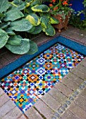 KARLA NEWELL GARDEN  BRIGHTON: SMALL TOWN GARDEN - MOSAIC LINED MOROCCAN STYLE POOL SURROUNDED BY HOSTAS