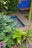 KARLA NEWELL GARDEN  BRIGHTON: SMALL TOWN GARDEN - HOSTAS ABOVE MOSAIC POOL