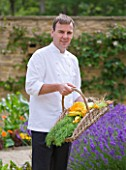 WHATLEY MANOR  WILTSHIRE: HEAD CHEF MARTIN BURGE WITH A TRUG FILLED WITH VEGETABLES IN THE KITCHEN GARDEN