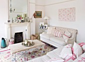 AMANDA KNOX HOUSE  GRANTHAM: SHABBY CHIC SITTING ROOM - LINEN COVERED SOFAS  WALL PAINTED IN FARROW AND BALL  ALL WHITE  FRENCH MIRROR ON MANTELPIECE ABOVE FIRE