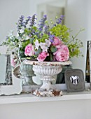 AMANDA KNOX HOUSE  GRANTHAM: THE LIVING ROOM - VINTAGE AND MODERN PICTURE FRAMES WITH WHITE CONTAINER FILLED WITH ROSES AND ALCHEMILLA MOLLIS ON MANTELPIECE ABOVE THE FIRE