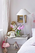 AMANDA KNOX HOUSE  GRANTHAM: WHITE BEDROOM - PAINTED BEDSIDE TABLE FROM ARDINGLY ANTIQUE FAIR  WITH OLD TELEPHONE AND TEDDY BEAR