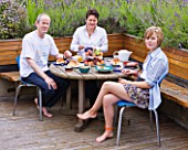 CHANTAL COADY AND HER HUSBAND JAMES  DAUGHTER MILLIE  12  ENJOYING AL FRESCO BREAKFAST ON THEIR ROOF TERRACE  SURROUNDED BY LAVENDER