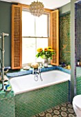 CHANTAL COADY HOUSE  LONDON: FRETWORK SCREENS AT THE WINDOW ABOVE BATH WITH MOROCCAN TILES - MOORISH BATHROOM