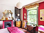 CHANTAL COADY HOUSE  LONDON: A ROCOCO OVERMANTEL AND THEATRICAL PELMET AT THE WINDOW SETS THE TONE I THE QUIRKY MAIN BEDROOM
