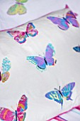 CHANTAL COADY HOUSE  LONDON: BUTTERFLY PRINTED BEDLINEN IN THE MAIN BEDROOM FROM LAURA ASHLEY