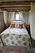 CHATEAU DU RIVAU  LOIRE VALLEY  FRANCE: THE BRIDAL ROOM BEDROOM WITH CANOPY BED IN THE ROYAL STABLES