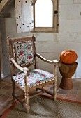 CHATEAU DU RIVAU  LOIRE VALLEY  FRANCE: THE BRIDAL ROOM BEDROOM WITH CHAIR IN THE ROYAL STABLES