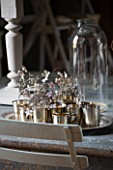 ROQUELIN  LOIRE VALLEY  FRANCE: DINING TABLE WITH SILVER TRAY AND TEA LIGHT HOLDERS WITH SILVER GREY HYDRANGEA FLOWERS