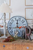 ROQUELIN  LOIRE VALLEY  FRANCE: KITCHEN; AN OLD WOODEN BUTCHERS BLOCK SERVES AS A DRESSER IN THE KITCHEN DECORATED WITH ZINC CLOCK  WOODEN PAINTED LAMP AND VINTAGE METAL LETTER R
