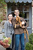 ROQUELIN  LOIRE VALLEY  FRANCE: OWNERS ALINE AND STEPHANE CHASSINE OUTSIDE THEIR RENOVATED FARMHOUSE WITH THEIR YOUNG DOG GARONNE
