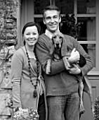 ROQUELIN  LOIRE VALLEY  FRANCE: BLACK AND WHITE IMAGE OF OWNERS ALINE AND STEPHANE CHASSINE OUTSIDE THEIR RENOVATED FARMHOUSE WITH THEIR YOUNG DOG GARONNE