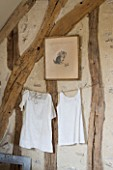 ROQUELIN  LOIRE VALLEY  FRANCE: CHILDS ROOM; A DECORATIVE DISPLAY OF KEEPSAKE BABY CLOTHES PINNED ON A WASHING LINE