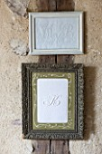 ROQUELIN  LOIRE VALLEY  FRANCE: SEWING ROOM; FRAMED VINTAGE FRENCH MONOGRAMS ON LINEN