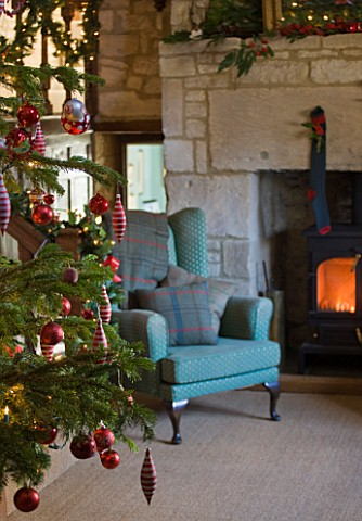 FULBROOK_HOUSE_GALLERIED_MAIN_HALL_WITH_COTSWOLD_STONE_FIREPLACE__LOG_BURNING_STOVE_AND_LEATHER_AND_