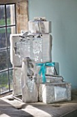 FULBROOK HOUSE: SITTING ROOM - WINDOWSILL WITH CHRISTMAS PRESENTS WRAPPED IN SILVER PAPER