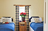 FULBROOK HOUSE: BEDROOM; BLUE AND CREAM TWIN BEDROOM WITH PLAID CURTAINS AND WOOL PLAID THROWS WITH CHRISTMAS POINSETTIA