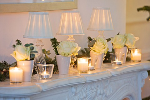 WHITE_HOUSE_SITTING_ROOM_DECORATIVE_MARBLE_FIREPLACE_WITH_WHITE_ROSES__CANDLES_AND_LAMPSHADES