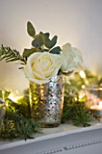 WHITE HOUSE: DINING ROOM - DECORATIVE WHITE MANTLE PIECE DRESSED FOR CHRISTMAS WITH PINE  EUCALYPTUS  ROSES AND SILVER AND GLASS TEA LIGHTS