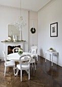 WHITE HOUSE: BREAKFAST ROOM: WHITE PAINTED TABLE AND CHAIRS  GLASS CHANDELIER AND WHITE FRAMED MANTLE MIRROR