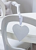 WHITE HOUSE: BREAKFAST ROOM: WHITE WOODEN CHAIR WITH WHITE HEART HANGING DECORATION