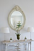 WHITE HOUSE: FAMILY ROOM; DECORATIVE CREAM WOODEN FRAMED MIRROR ABOVE WHITE DECORATIVE CONSOLE TABLE DRESSED WITH WHITE HYACINTHS  ORCHIDS AND PUSSY WILLOW