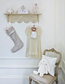 WHITE HOUSE: GIRLS BEDROOM - DECORATIVE SHELF HUNG WITH LINEN CHRISTMAS STOCKING AND PRETTY DRESS