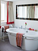 TARA NASH-KING HOUSE  LONDON: PHILIPPE STARCK BATHTUB AND MISSONI TOWELS IN BEDROOM OF TARA NASH-KING