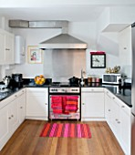 TARA NASH-KING HOUSE  LONDON: THE KITCHEN IN THE NOTTING HILL HOME OF CLOTHES DEALER TARA NASH-KING