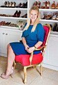 TARA NASH-KING HOUSE  LONDON: TARA NASH-KING ON REPRO LOUISE CHAIR IN HER SHOE SALES AREA AT HER WORKSPACE IN HER NOTTING HILL HOME