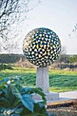 DAVID HARBER SUNDIALS: EARLY MORNING IMAGE OF THE MANTLE  A VERDIGRIS BRONZE SPHERE CONSISTING OF DOZENS OF INDIVIDUAL BRONZE PETALS WELDED TOGETHER