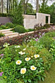 CHELSEA 2012 - ANDY STURGEON GARDEN FOR M & G INVESTMENTS - PEONY CLAIRE DE LUNE IN FOREGROUND WITH LIMESTONE WALL BEHIND
