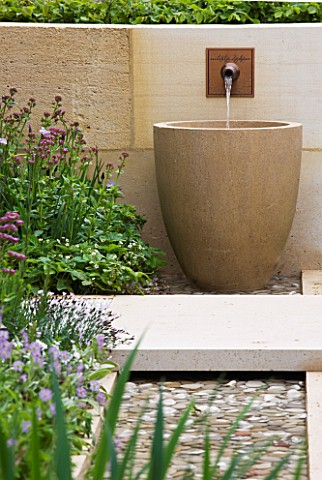 CHELSEA_2012__LAURENT_PERRIER_GARDEN_BY_ARNE_MAYNARD__WALL_WATER_SPOUT_FALLING_INTO_LARGE_CONTAINER