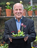 W & S LOCKYER AURICULA NURSERY -  AURICULA EXPERT AND GROWER WILLIAM LOCKYER PREPARES FOR THE CHELSEA FLOWER SHOW