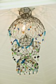 CHELSEA 2012 - CHANDELIER BMADE FROM OLD WIRE GARDEN HANGING BASKETS BY ANNABEL LEWIS