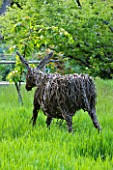 MILLE FLEURS  GUERNSEY: WOVEN WILLOW DONKEY IN GRASS